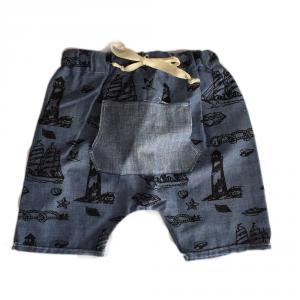 Shorts neonato in cotone biologico con tasca