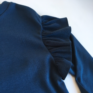 Maglia manica lunga con volant in cotone biologico blu