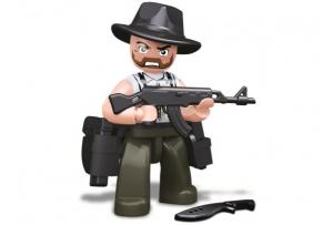 Personaggio Costruzioni Sluban rapinatore con cappello da cowboy e mitragliatrice