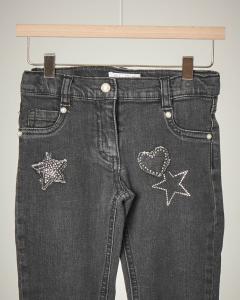 Jeans grigio applicazioni
