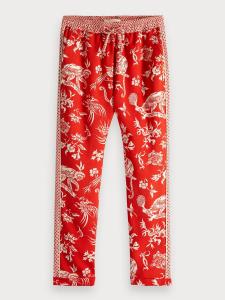 Pantalone rosso con fantasia bianca