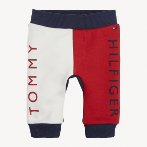 Pantalone in tuta rosso e bianco con stampa scritta