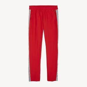 Pantalone in tuta rosso con righe bianche e nere