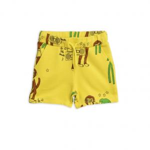 Pantaloncini in tuta gialli con stampe scimmie marroni