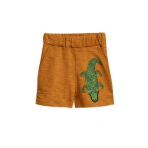 Pantaloncini in tuta marroni con stampa coccodrillo verde
