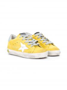 Scarpe gialle con stella bianca