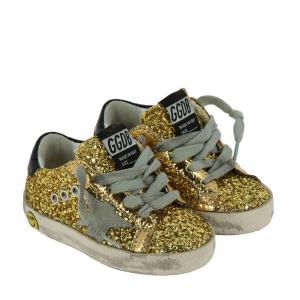 Scarpe oro con stella grigia