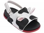 Sandali neri e bianchi con fibbia e fantasia mucca