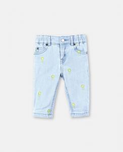 Jeans celeste con stampa palme gialle