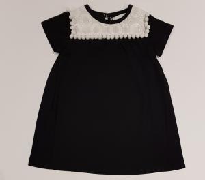 Vestito nero con colletto e pompon bianchi