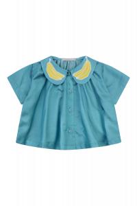 Camicia azzurra con banane gialle