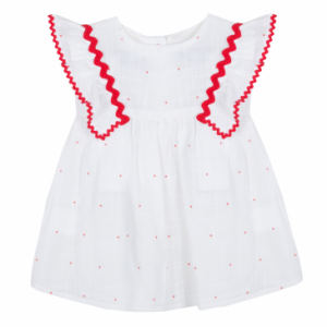 Vestito bianco con dettagli e pois rossi