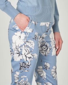 Pantaloni azzurri in cotone elasticizzato a stampa floreale