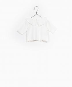 Camicia bianca con colletto ampio