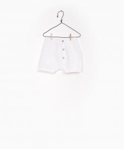 Pantaloncino bianco con chiusura a bottoni