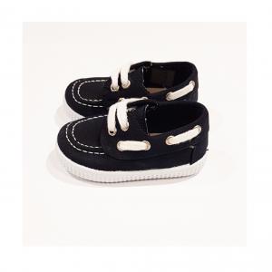 Scarpe nere con lacci, cuciture e suola bianchi