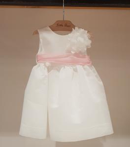 Vestito bianco con fascia rosa e fiore