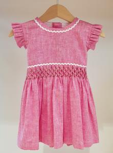 Vestito rosa con dettagli bianchi e verdi