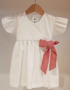 Vestito bianco con fiocco rosso