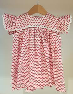 Vestito bianco con pois rossi e dettagli bianchi