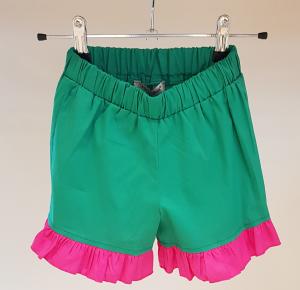 Pantaloncino verde con fondo fucsia