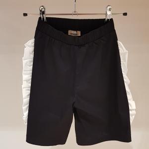 Pantalone nero con volant bianchi