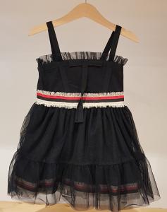 Vestito nero con bande rossa, nera e bianca