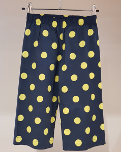 Pantalone blu con pois gialli