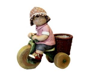 Gnomo decorativo bimba con triciclo