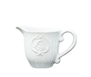 Lattiera ceramica bianca