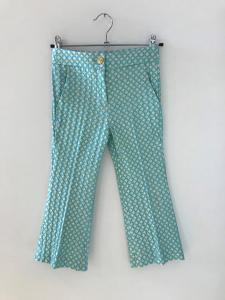 Pantalone turchese con rombi bianchi e oro