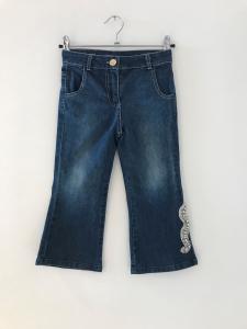 Jeans con serpente a strass