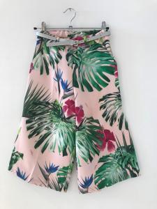 Pantalone rosa con stampe foglie e fiori multicolore