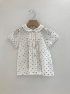Blusa bianca con ricami beige