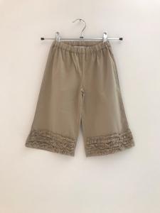 Pantalone beige con rouge