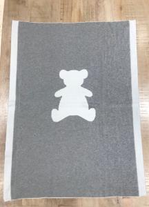 Coperta bianca e grigia scura con stampa orso