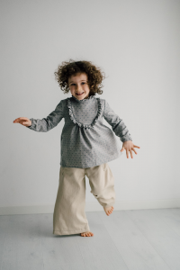 Flared trousers in cream-colored organic cotton fleece denim