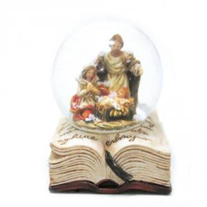 Sfera di neve con natività su libro in vetro
