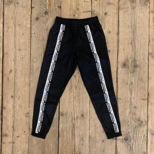 Pantalone Adidas Track Pant Neri con Strisce Bianche