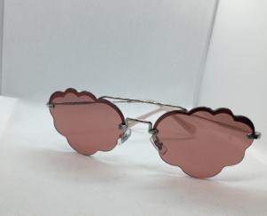 Occhiale sole Donna Miu Miu modello SMU 57U