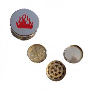Tritatabacco Grinder fiamme 3 parti regalo uomo articolo per fumatori 5x3 cm