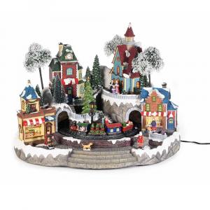 Paesaggio di Natale con albero e trenino in movimento luci e musica