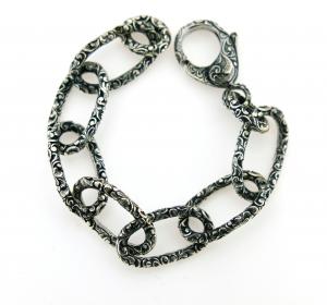 Bracciale in argento intarsiato anelli ovali