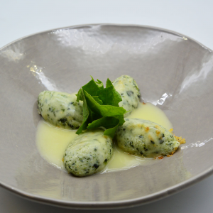Gnocchi di ricotta e spinaci gratinati con parmigiano e burro di malga