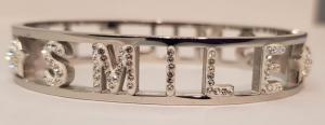 bracciale acciaio silver manetta  scritte smile  strass