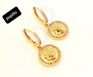 orecchino metallo gold schiona zirconi e pendente disco