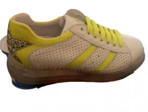 Sneakers donna | in pelle bianca | dettagli giallo fluo | cerniera laterale interna  | fondo gomma trasparente | Made in Italy