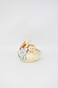 Oggetto In Ceramica Egan Bambino Con Cicogna.