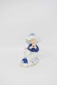 Statuina Ceramica Capodimonte Bambino Seduto H 11 Cm