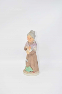 Statua Donna Anziana Con Vaso 17 Cm